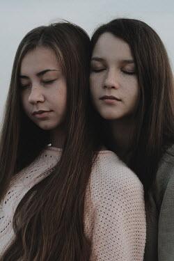 Alina Zhidovinova CLOSE UP OF TWO TEENAGERS DAYDREAMING Children