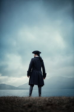 Magdalena Russocka historical man in tricorn hat standing by sea