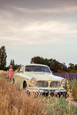 Ysbrand Cosijn WOMAN BY CLASSIC CAR IN SUMMERY COUNTRYSIDE Women