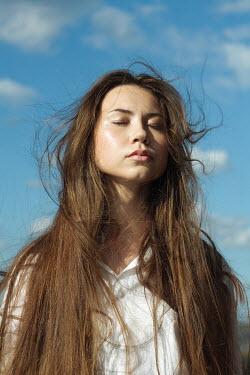 Alina Zhidovinova BRUNETTE GIRL DREAMING WITH BLUE SKY Women