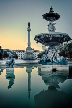 Evelina Kremsdorf FOUNTAIN AND STATUES IN CITY AT DUSK Specific Cities/Towns