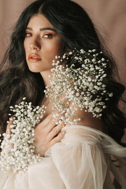 Jovana Rikalo SERIOUS BRUNETTE WOMAN WITH WHITE FLOWERS Women