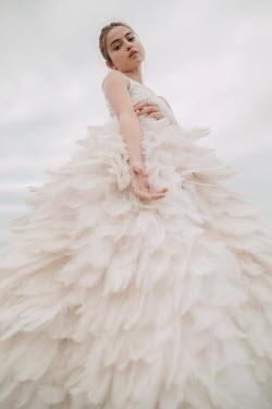 Jovana Rikalo GIRL IN WHITE FEATHERY DRESS FROM BELOW Women