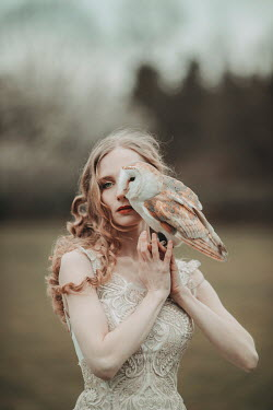Jovana Rikalo WOMAN OUTDOORS IN LACE GOWN WITH OWL Women