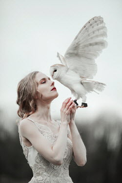Jovana Rikalo WOMAN OUTSIDE HOLDING WHITE OWL Women