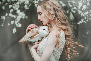 Jovana Rikalo WOMAN HOLDING OWL BY TREE IN BLOSSOM Women
