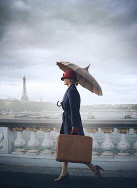 Mark Owen WOMAN WITH UMBRELLA CARRYING SUITCASE IN PARIS Women
