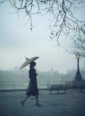 Mark Owen WOMAN WITH UMBRELLA WALKING IN CITY AT DUSK Women