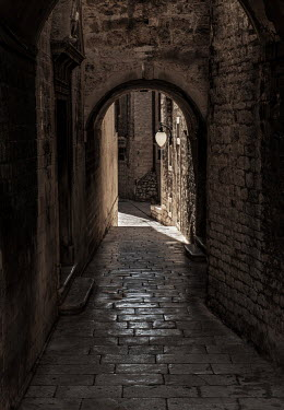 Jaroslaw Blaminsky EMPTY HISTORICAL ALLEYWAY WITH STONE ARCH Streets/Alleys