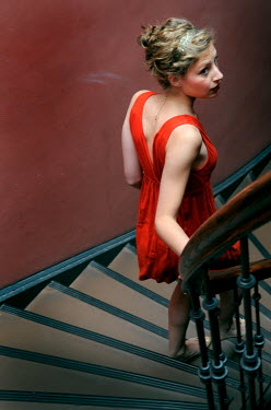 Ute Klaphake BLONDE WOMAN DESCENDING STAIRCASE FROM ABOVE Women