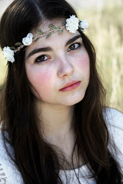 Ute Klaphake CLOSE UP OF BRUNETTE GIRL WITH FLORAL HEADBAND Women