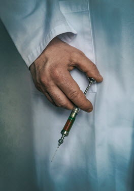 Jaroslaw Blaminsky CLOSE UP OF MALE DOCTOR HOLDING SYRINGE Men