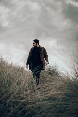 Rekha Garton MAN WITH BEARD WALKING IN IN LONG GRASS Men
