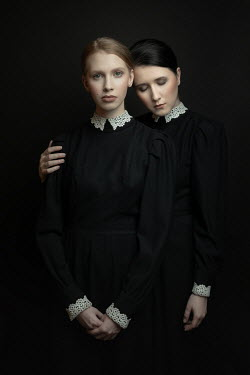 Dorota Gorecka Young women in black Victorian dresses side by side