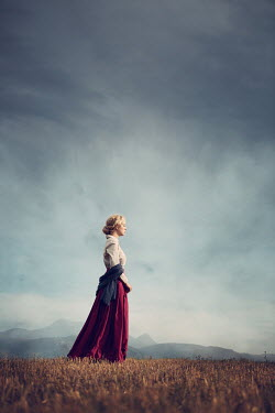 Magdalena Russocka historical woman walking in countryside with mountains