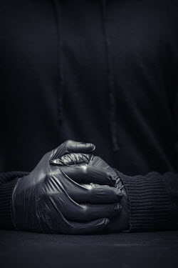 Paolo Martinez Hands of man wearing black rubber gloves