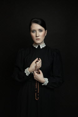 Dorota Gorecka WOMAN IN BLACK HOLDING ROSARY Women