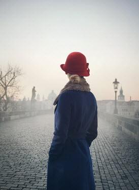 Mark Owen WOMAN IN COAT AND HAT ON BRIDGE Women