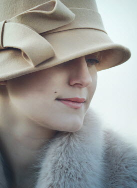Mark Owen Young woman in cloche hat and fur scarf