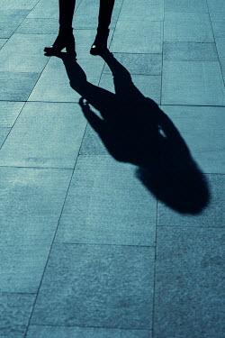 Mohamad Itani Shadow of woman on footpath