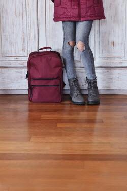 Tanya Gramatikova Legs of girl standing by backpack