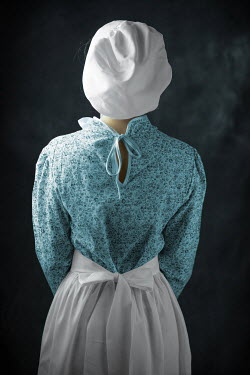 Ildiko Neer Historical servant in apron and bonnet