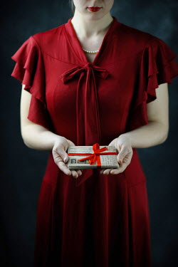 Ildiko Neer Vintage woman holding letters with red ribbon