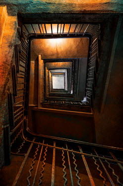 Jaroslaw Blaminsky OLD TALL METAL STAIRCASE FROM BELOW Stairs/Steps