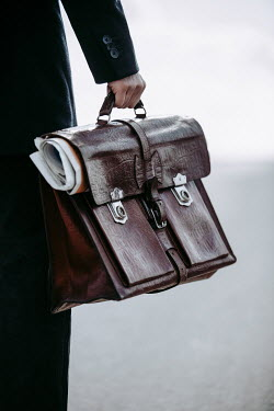 Magdalena Russocka close up of man holding briefcase Men