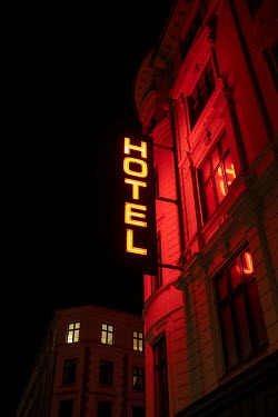 Colin Hutton NEON SIGN OUTSIDE HOTEL AT NIGHT Miscellaneous Buildings