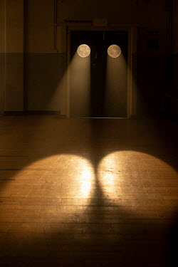 Colin Hutton LIGHT SHINING THROUGH CIRCLES IN DOORWAY Interiors/Rooms