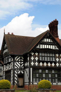 Ute Klaphake EXTERIOR OF BLACK AND WHITE TUDOR BUILDING Houses