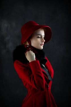 Ildiko Neer Victorian woman touches her fur collar