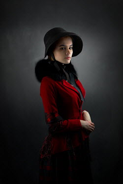 Ildiko Neer Historical woman in red coat and black bonnet