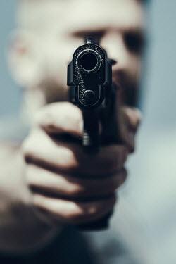 Magdalena Russocka close up of man aiming with gun