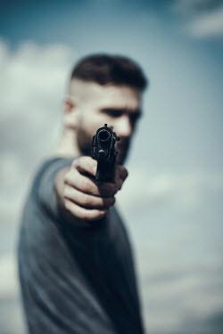 Magdalena Russocka man aiming with gun