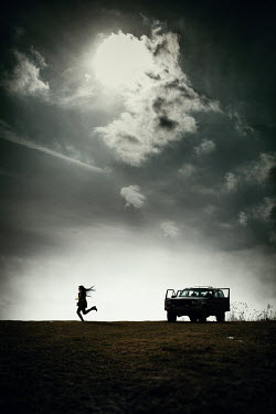 Magdalena Russocka silhouette of running woman and truck in countryside