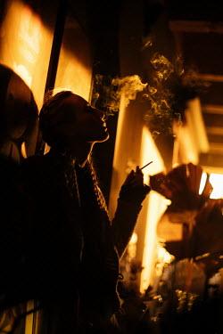 Marta Syrko GIRL WITH PLAITS SMOKING AT NIGHT Women