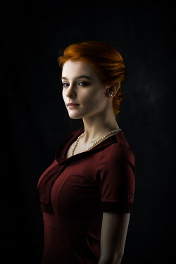 Ildiko Neer Red hair retro woman in burgundy dress
