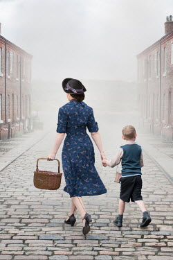 Lee Avison 1940s wartime woman and boy walking on a cobbled street