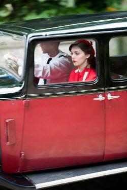 Lee Avison 1940s couple driving a vintage car
