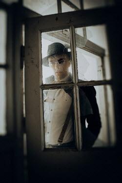 Natasza Fiedotjew Man in black investigating bullet hole in glass door