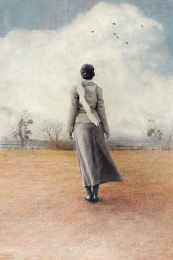 Anna Buczek WOMAN IN SKIRT AND JACKET WATCHING COUNTRYSIDE Women