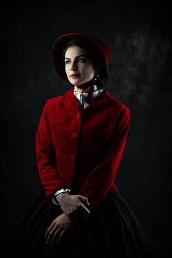 Ildiko Neer Historical woman wearing red coat and bonnet