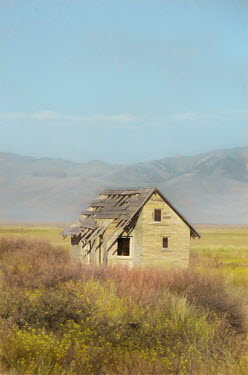 Jill Battaglia DERELICT HOUSE IN COUNTRY WITH MOUNTAINS Houses