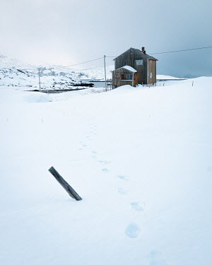 Paul Sheen HOUSE BY LAKE WITH FOOTPRINTS IN SNOW Houses