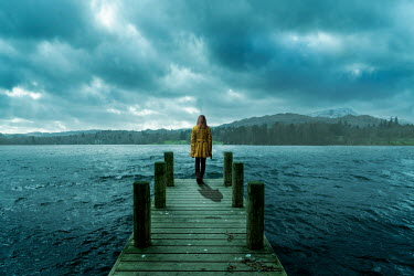 Stephen Mulcahey WOMAN STANDING ON JETTY WATCHING STORMY LAKE Women