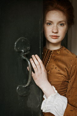 Shelley Richmond CLOSE UP OF HISTORICAL WOMAN OPENING DOOR Women