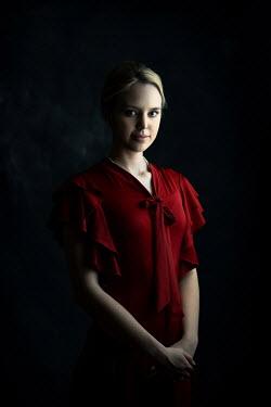 Ildiko Neer Young blonde retro woman in red dress