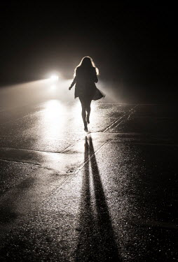 Terry Bidgood SILHOUETTED GIRL RUNNING FROM CAR AT NIGHT Women